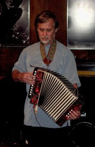 Paul playing the accordion.